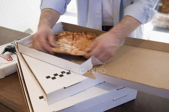 Man taking piece of pizza — Stock Photo