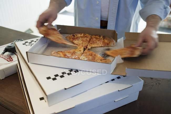 Man taking piece of pizza — Stock Photo