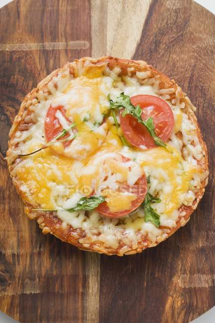 Mini pizza with tomato and cheese — Stock Photo