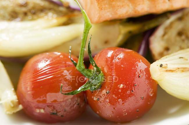 Cherry tomatoes with salmon — Stock Photo