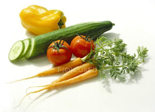 Assorted Vegetables - cucumber, carot, pepper and herbs  on white background — Stock Photo