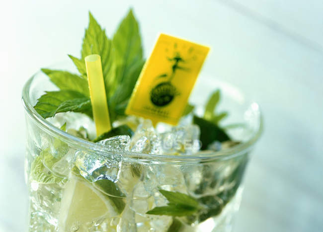 Mojito cocktail in glass with ice — Stock Photo