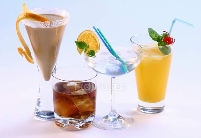 Several cocktails in elegant glasses — Stock Photo