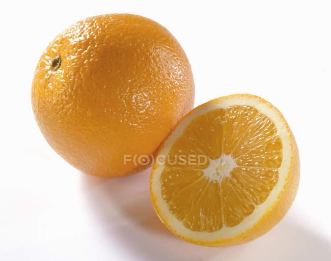 Fresh orange with half — Stock Photo
