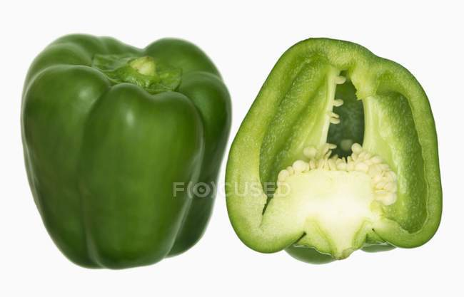 Green pepper with half — Stock Photo