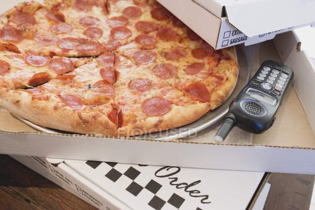 Pepperoni pizza in pizza box — Stock Photo