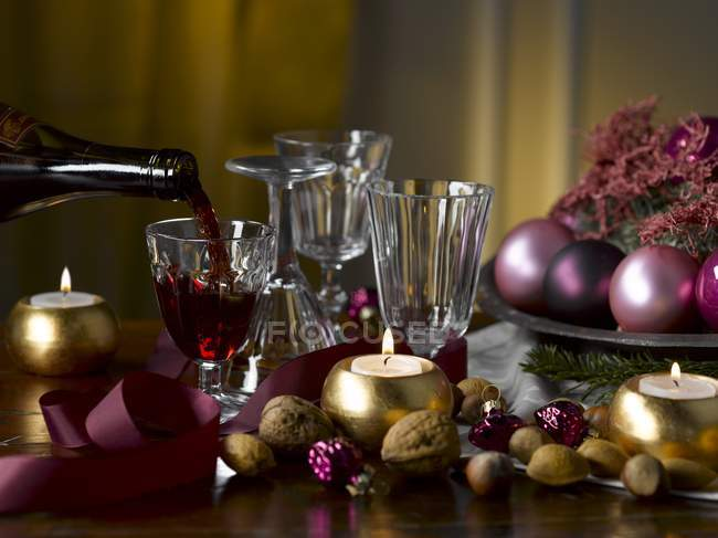 Christmas decorations and red wine — Stock Photo