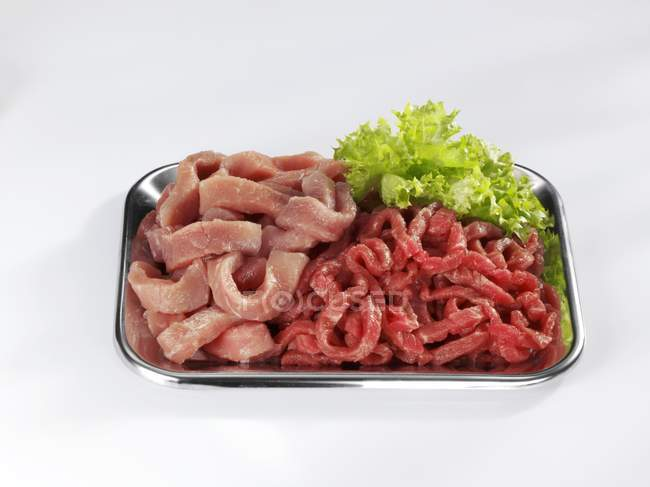 Veal and beef, cut into strips — Stock Photo