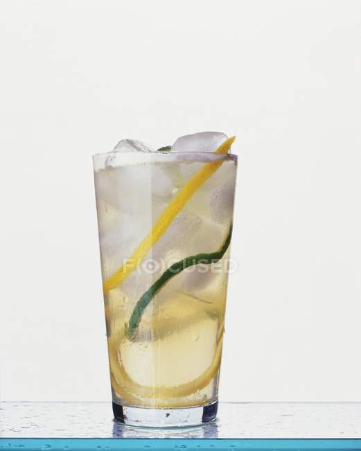 Metaxa and lemonade cocktail in glass — Stock Photo