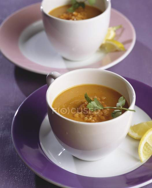 Red lentil soup with fresh coriander — Stock Photo