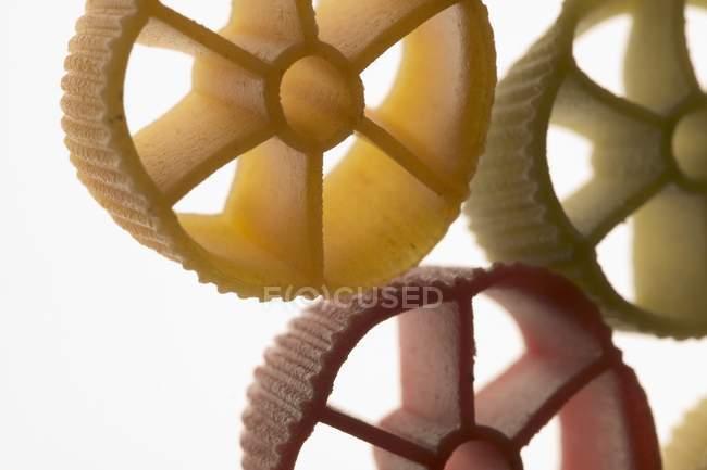 Coloured pasta wheels — Stock Photo