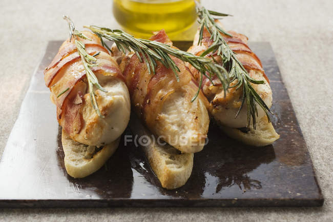 Chicken breasts wrapped in bacon — Stock Photo