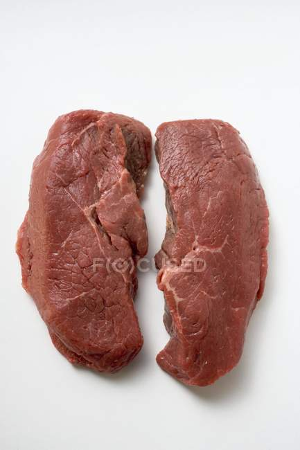 Slices of raw beef sirloin — Stock Photo