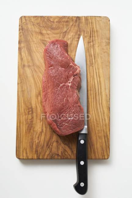Raw Beef sirloin with knife — Stock Photo