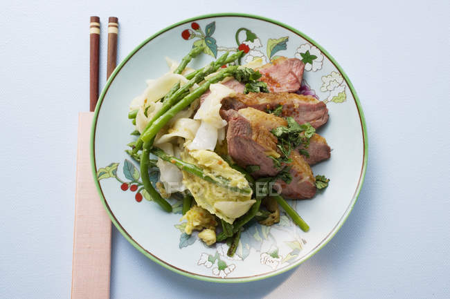 Duck breast with rice noodles — Stock Photo