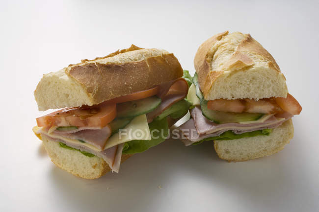 Baguette with ham and cheese — Stock Photo