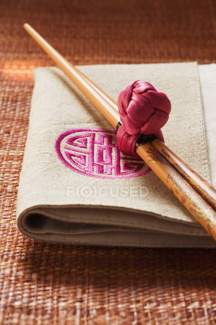 Chopsticks with decoration knot — Stock Photo