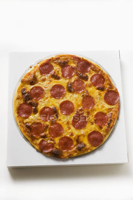 Whole salami and cheese pizza — Stock Photo