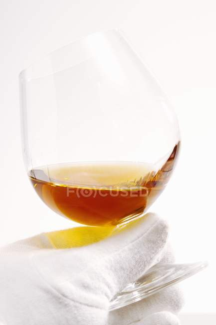 Glass of fine cognac — Stock Photo