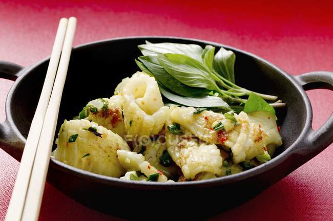 Spicy squid with Thai basil — Stock Photo
