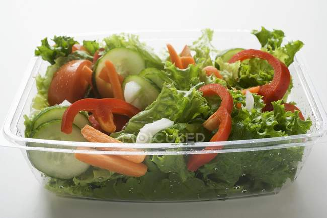Salad leaves with cucumber — Stock Photo