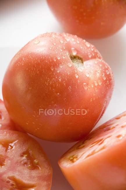 Halved and sliced Tomatoes — Stock Photo