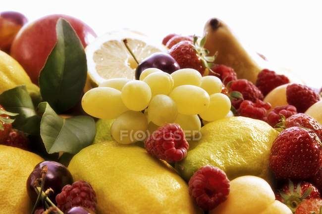 Fresh picked berries with lemons — Stock Photo