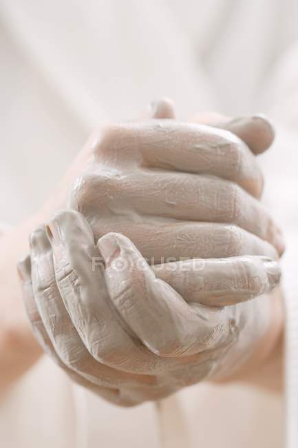 Closeup view of hands coated with cream — Stock Photo