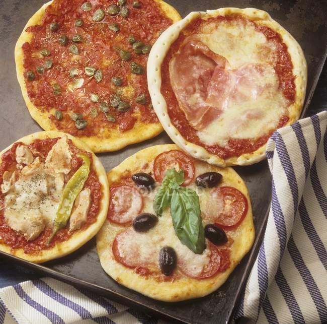 Four small pizzas — Stock Photo