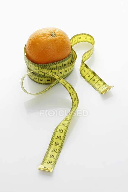 Orange with tape measure — Stock Photo