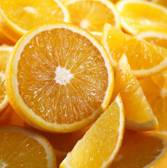 Orange halves and wedges — Stock Photo