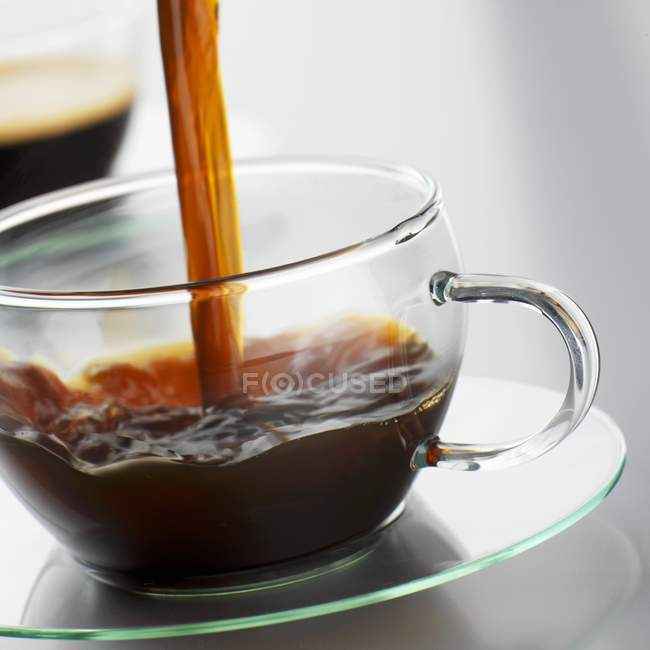 Pouring coffee into glass cup — Stock Photo
