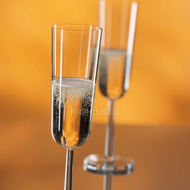 Elegant glasses of sparkling wine — Stock Photo