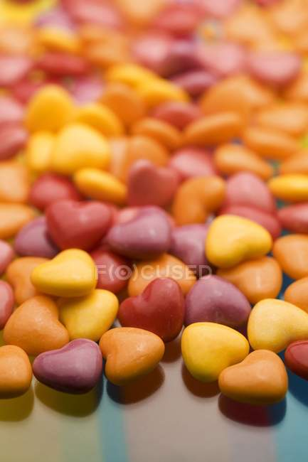 Closeup view of colored sugar hearts — Stock Photo