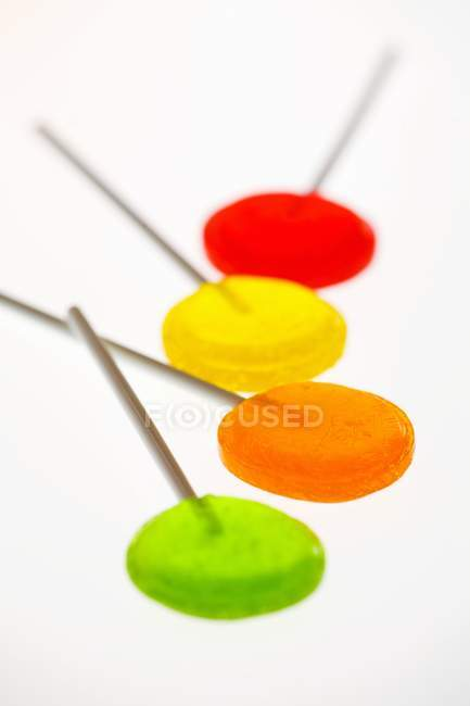Four coloured lollipops — Stock Photo