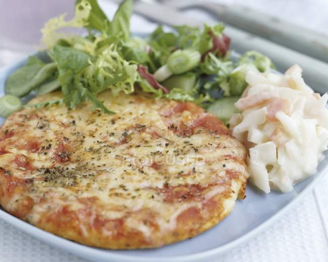 Mini pizza with salad — Stock Photo