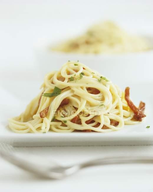 Spaghetti alla carbonara with meat — Stock Photo