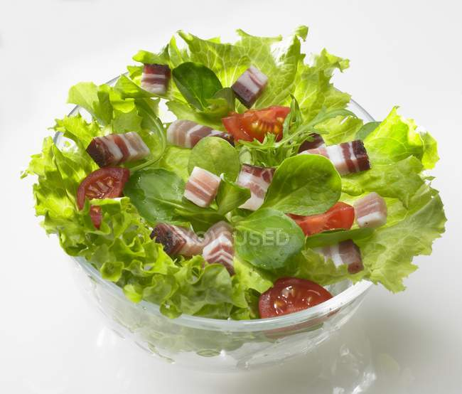 Green salad with diced bacon — Stock Photo