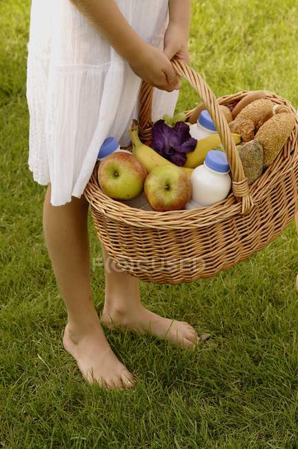 Basket full of groceries — Stock Photo