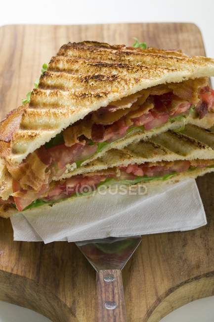 Toasted bacon, lettuce and tomato sandwiches — Stock Photo