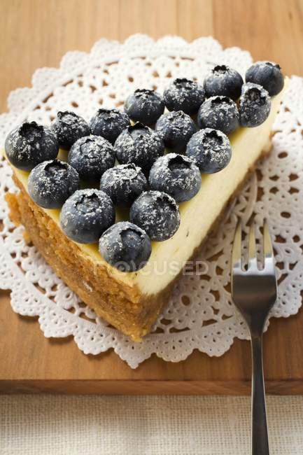 Piece of blueberry cheesecake — Stock Photo