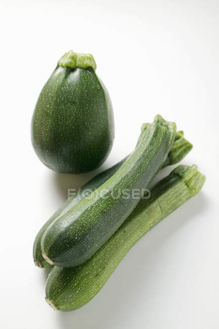 Green Round and long courgettes — Stock Photo