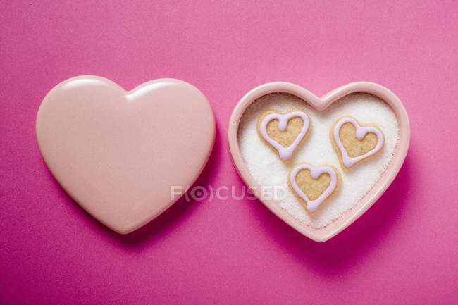 Heart-shaped biscuits in sugar bowl — Stock Photo