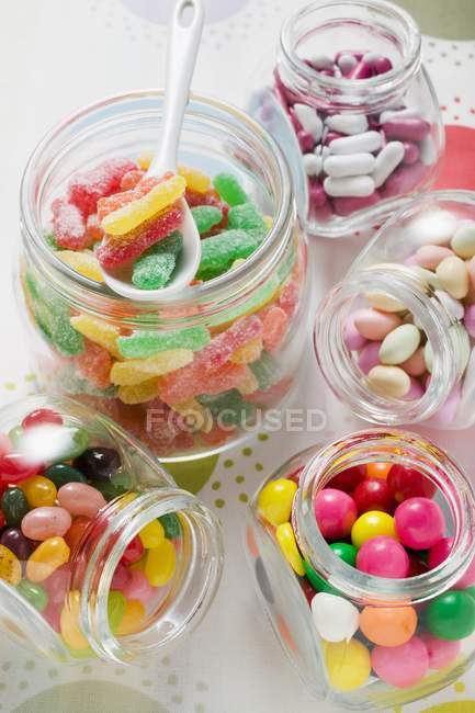 Assorted sweets in storage jars — Stock Photo