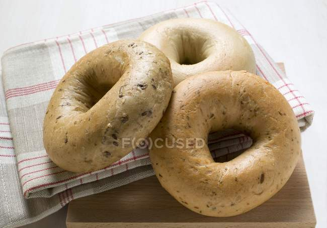 Three different bagels on napking — Stock Photo