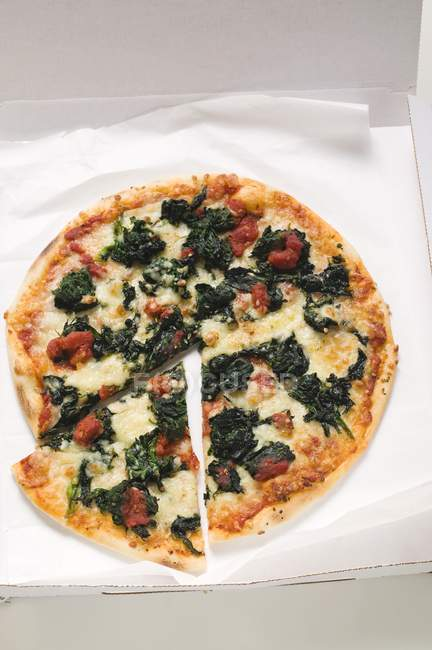 Pizza slices in box — Stock Photo