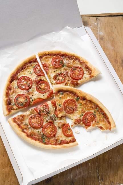 Tomato pizza with oregano — Stock Photo