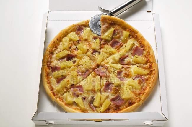 Pizza sliced in box — Stock Photo