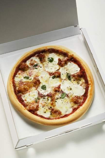 Mozzarella pizza with tomato sauce — Stock Photo