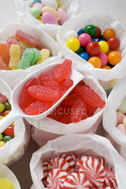 Assorted sweets in paper bags — Stock Photo